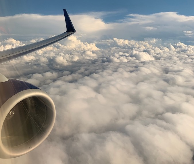 Airplane Flying on clouds